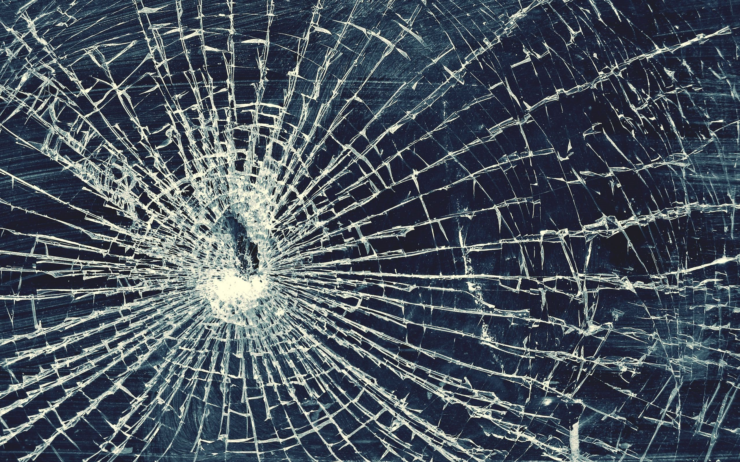 broken-glass-bullet-hole-cracked-glass.jpg